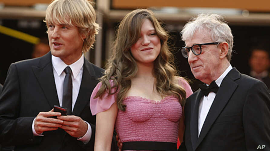From left, actors Owen Wilson and Lea Seydoux stand with Director Woody Allen as they arrive for the screening of 'Midnight in Paris' and the opening ceremony, at the 64th international film festival, in Cannes, southern France, May 11, 2011.