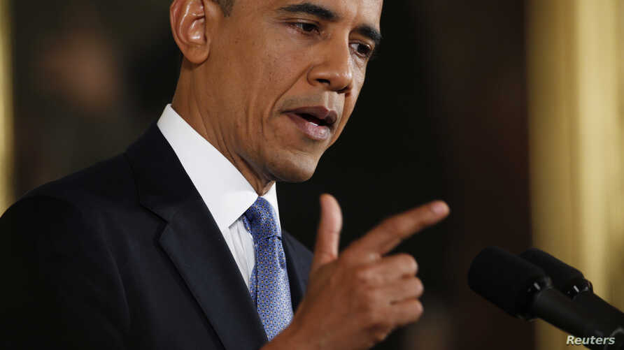U.S. President Barack Obama gestures while addressing his first news conference since his re-election, at the White House in Washington November 14,  2012.
