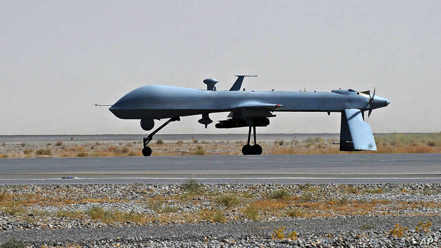 FILE -  U.S. Predator unmanned drone armed with a missile stands on the tarmac of Kandahar military airport in Afghanistan.