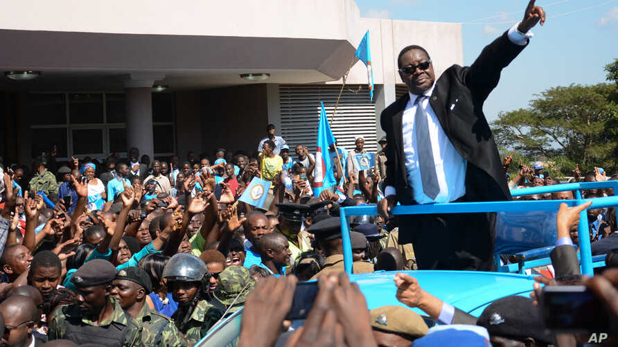 FILE - Newly elected Malawian president Peter Mutharika greets supporters after he was sworn in at the High Court in Blantyre, Malawi, May 31, 2014.