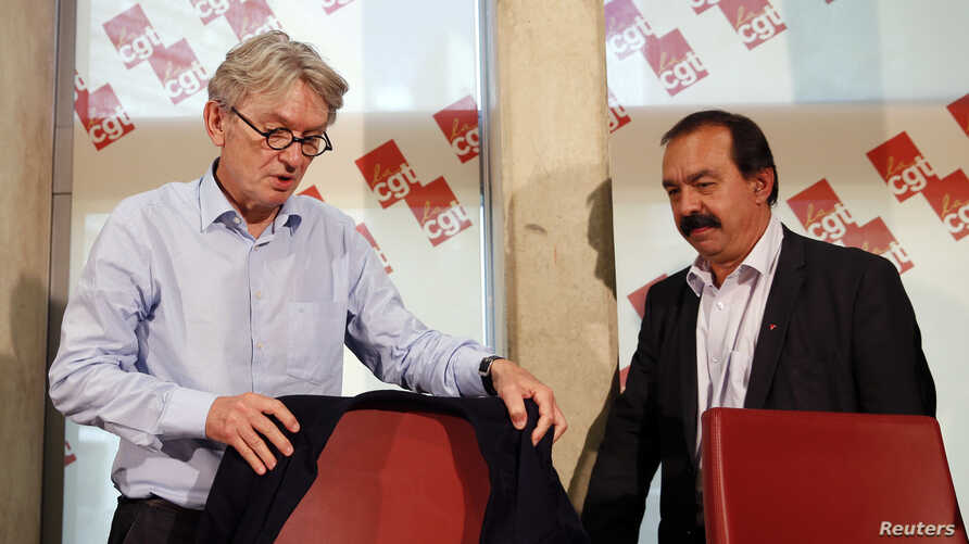 French Force Ouvriere (FO) labor union General Secretary Jean-Claude Mailly (L) and French CGT trade union head Philippe Martinez attend a news conference in Montreuil, outside Paris, France, June 22, 2016.
