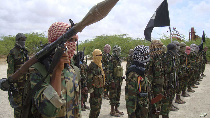 Al-Shabaab fighters display weapons as they conduct military exercises in northern Mogadishu, Somalia, Oct. 21, 2010 file photo.