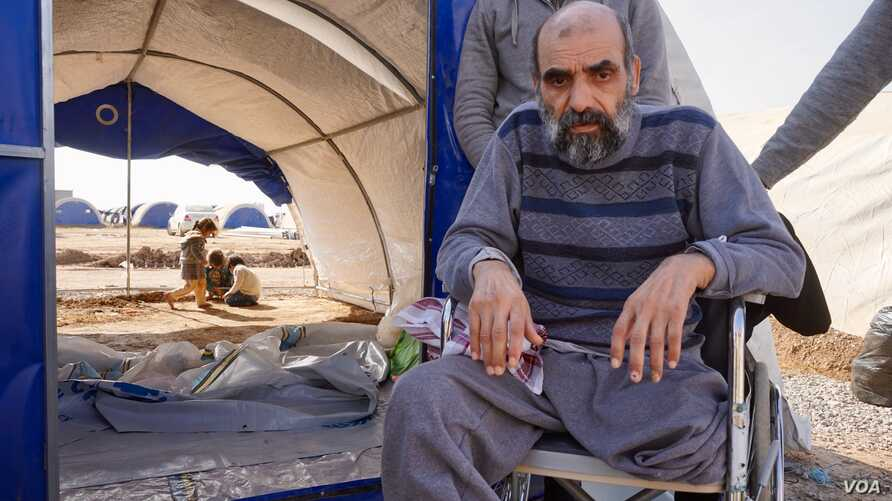 Wheel-chair bound Natiq from Mosul lost a leg to diabetes. His family pushed the 60-year-old for three hours to get out of the war zone.
