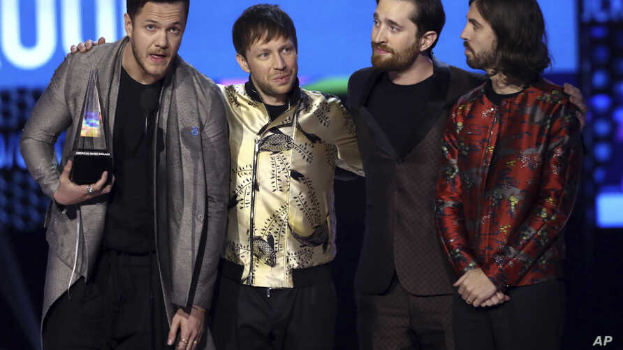 Dan Reynolds, from left, Ben McKee, Daniel Platzman, and Daniel Wayne Sermon of Imagine Dragons accept the award for favorite duo or group at the American Music Awards at the Microsoft Theater on Nov. 19, 2017, in Los Angeles.