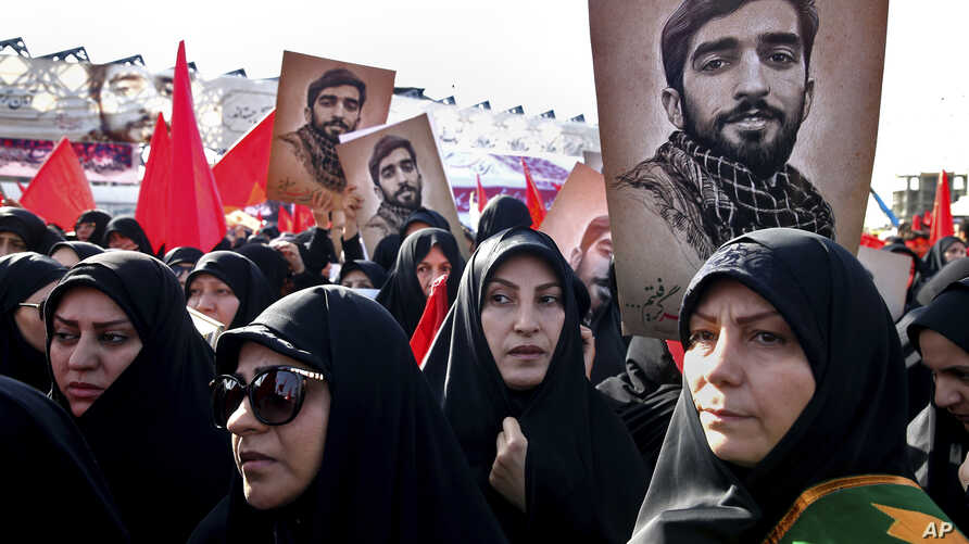 Thousands of Iranians attend the state funeral of Mohsen Hojaji, a young Revolutionary Guard soldier beheaded by the so-called Islamic State group in Syria, Wednesday, Sept. 27, 2017, in Tehran, Iran.
