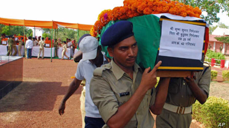 Policemen carry the flag-draped coffin of their colleague, one of nine officers killed by dozens of suspected Maoist rebels, on the outskirts of Raipur, capital of the eastern Indian state of Chhattisgarh, May 24, 2011