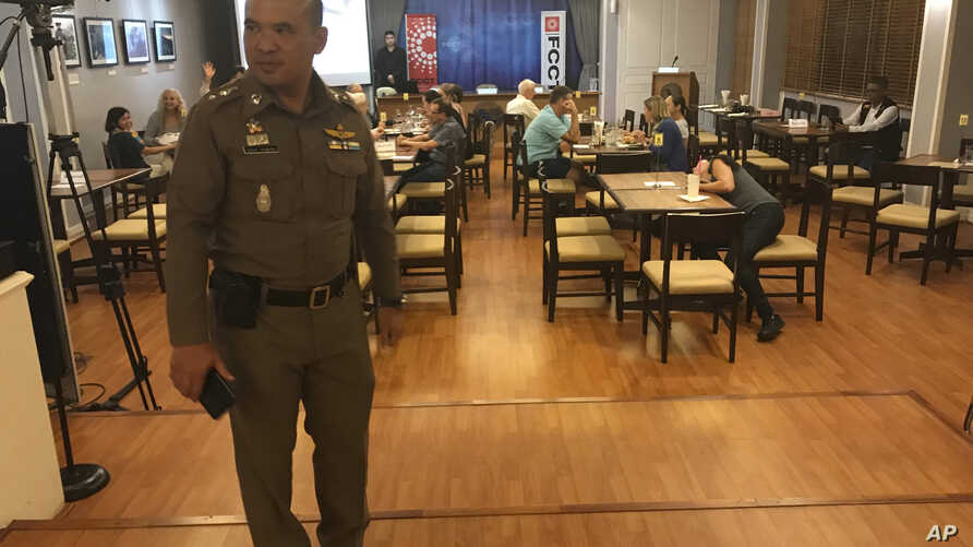 """In this Monday Sept. 10, 2018, photo, a Thai policeman stands inside Foreign Correspondents' Club of Thailand during an event titled: """"Will Myanmar's General Ever Face Justice for International Crimes"""" in Bangkok, Thailand."""