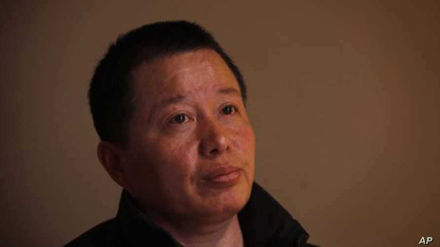 Gao Zhisheng, a human rights lawyer, pays attention to a question during his first meeting with the media since he resurfaced two weeks ago, at a tea house in Beijing, China, Wednesday, April 7,  2010.  Gao, whose disappearance more than a year ago c
