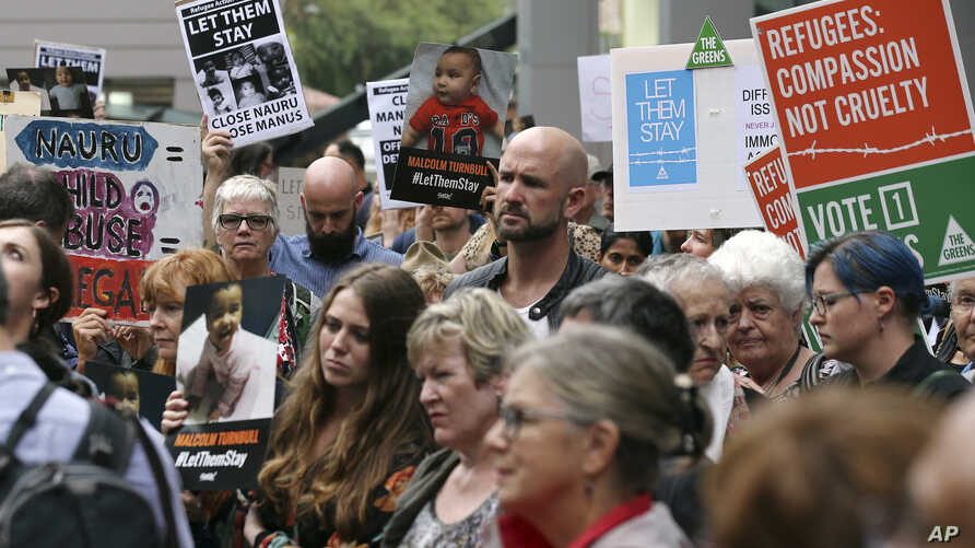 Protestors against asylum seekers being deported, gather for a rally in Sydney, Australia, Thursday, Feb. 4, 2016. Australia was resisting mounting international pressure not to deport child asylum seekers, with a minister warning on Thursday that al