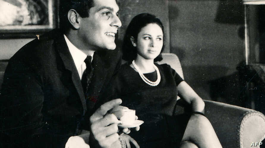 FILE - A handout photo showing Egyptian actress Faten Hamama, right, and her husband, Egyptian born actor Omar Sharif, in Cairo, Egypt.