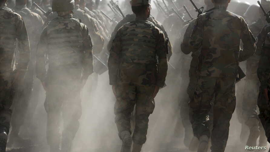 FILE - Afghan National Army (ANA) officers march during a training exercise at the Kabul Military Training Centre in Afghanistan, Oct. 7, 2015.