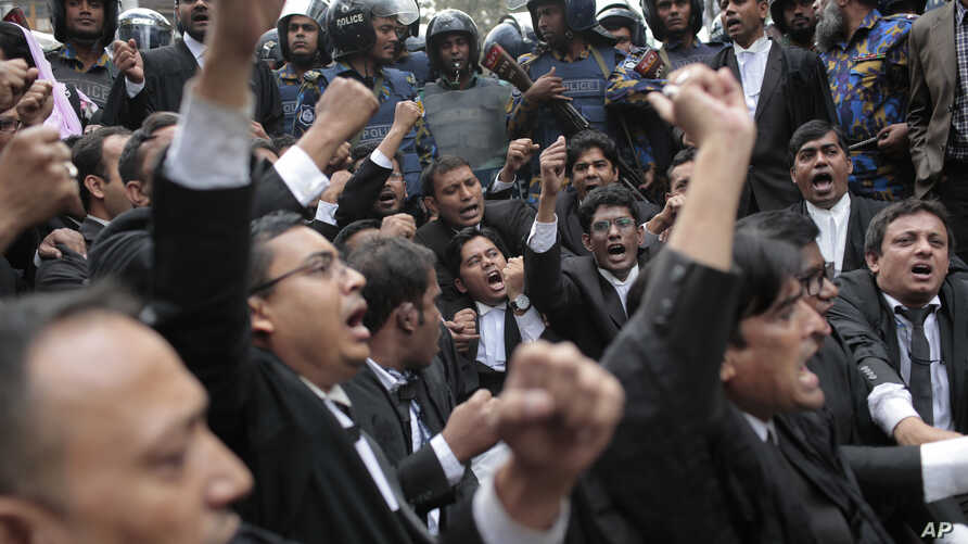 FILE - Lawyers supporting the Bangladesh Nationalist Party shout slogans outside a court against a verdict against former Prime Minister Khaleda Zia in Dhaka, Feb. 8, 2018.