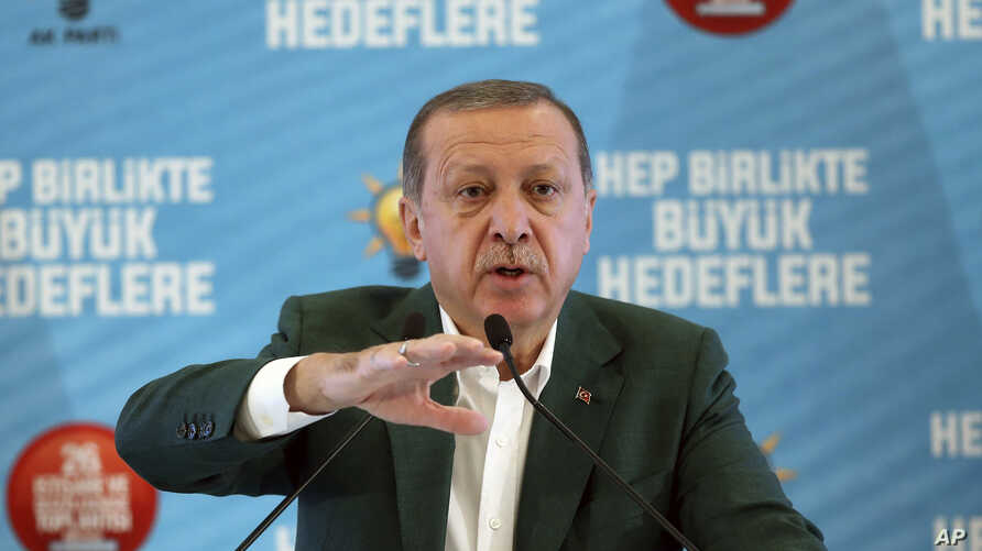 """Turkey's President Recep Tayyip Erdogan gestures as he delivers a speech at his ruling political party's conference in Afyonkarahisar province in western Turkey, Oct. 7, 2017. Erdogan has announced the country is conducting a """"serious"""" operation agai"""