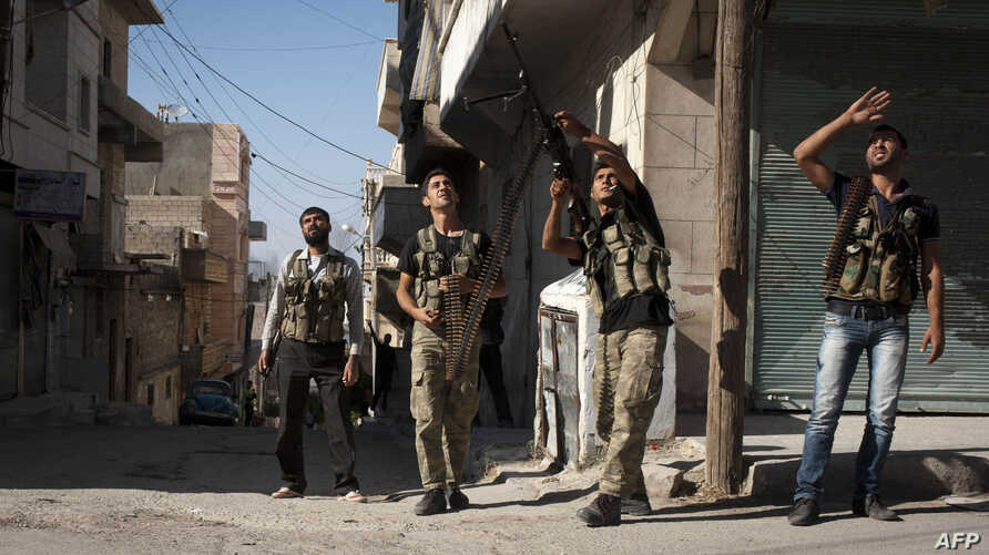 Free Syrian Army fighters train a gun on a Syrian war plane in the Bustan Pasha neighbourhood of Syria's northern city of Aleppo, Aug. 23, 2012.