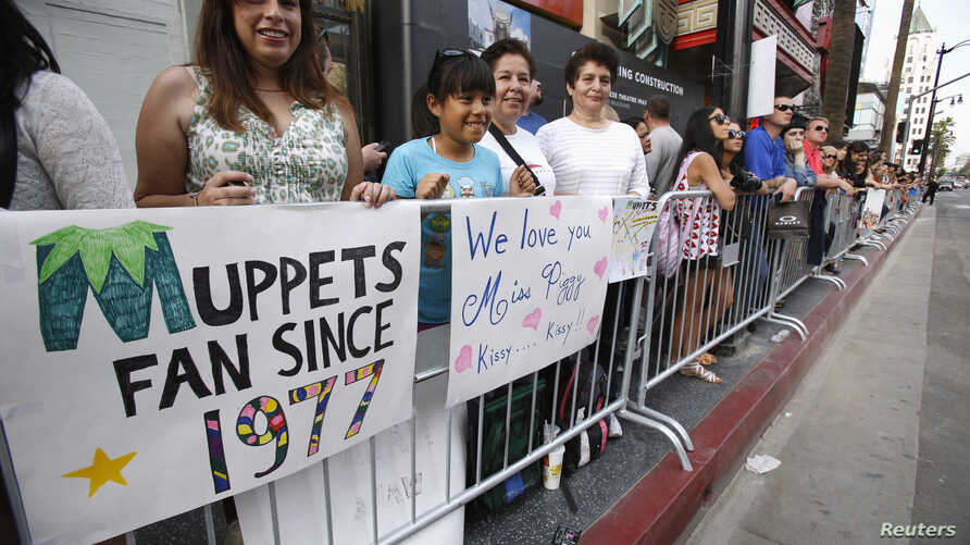 "FILE - Fans wait at the premiere of ""Muppets Most Wanted"" at El Capitan theatre in Hollywood, Calif., March 11, 2014."