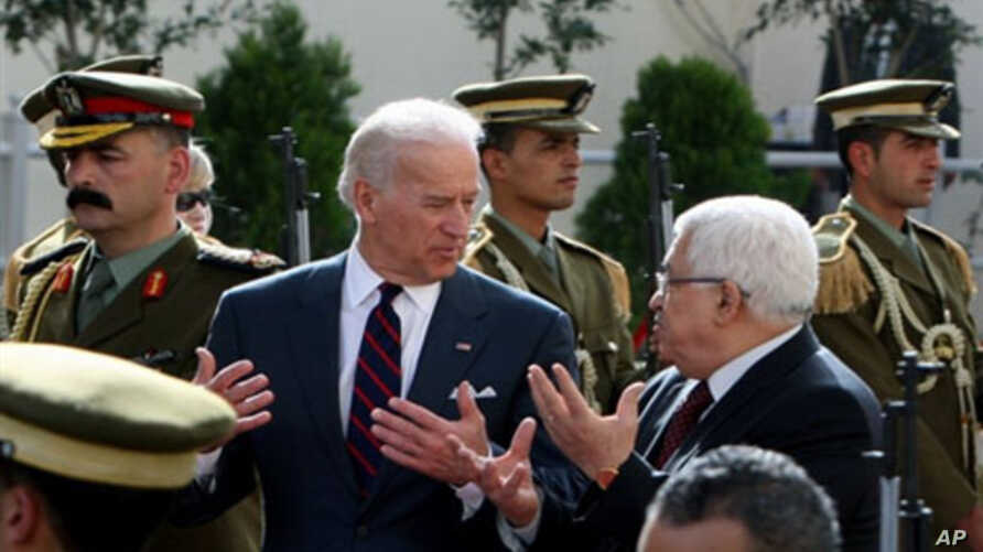 Palestinian president Mahmud Abbas (R) welcomes US Vice President Joe Biden (L) prior to their meeting in the West Bank city of Ramallah, 10 Mar 2010