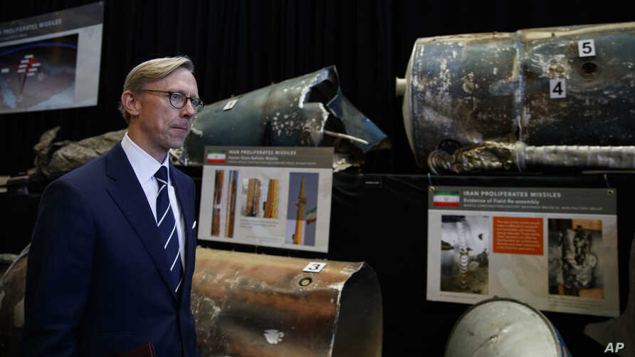 Brian Hook, U.S. special representative for Iran, walks past fragments of Iranian short range ballistic missiles (Qiam) at the Iranian Materiel Display (IMD) at Joint Base Anacostia-Bolling, in Washington, Nov. 29, 2018. The Trump administration accu
