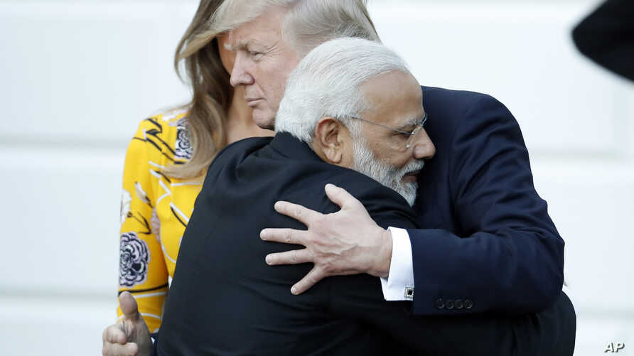Indian Prime Minister Narendra Modi hugs President Donald Trump as Modi departs the White House, June 26, 2017.