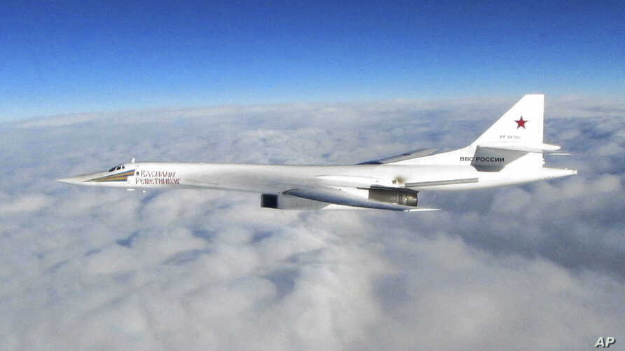 In this image made available by the Royal Air Force, Jan. 15, 2018, one of Russian Blackjack Tupolev Tu-160 long-range bombers is photographed by an RAF aircraft, scrambled from RAF Lossiemouth, Scotland.