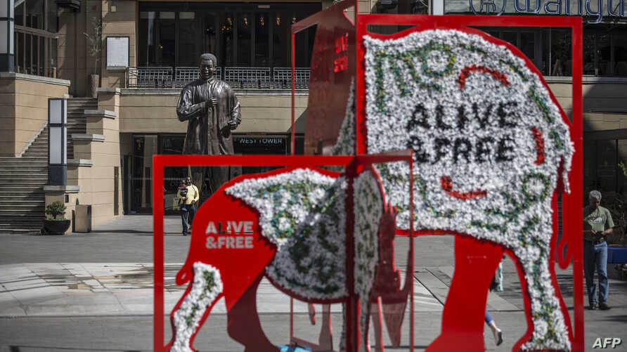 An installation showing a rhino and an elephant is seen in Mandela Square as part of the CITES (Convention on International Trade in Endangered Species of Wild, Fauna and Flora) convention in Johannesburg, South Africa, Sept. 26, 2016.