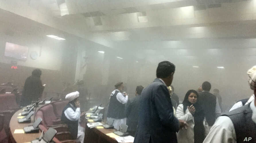 A photo taken by Afghan member of parliament Naqibullah Faiq shows lawmakers leaving the main hall after a suicide attack in front of  Parliament, during clashes with Taliban fighters in Kabul, June 22, 2015.