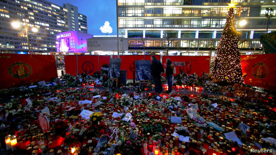 Flowers and candles are placed at the former Christmas market at Breitscheid square in Berlin, Germany, Jan. 3, 2017, following an attack by a truck in December which plowed through a crowd at the market.