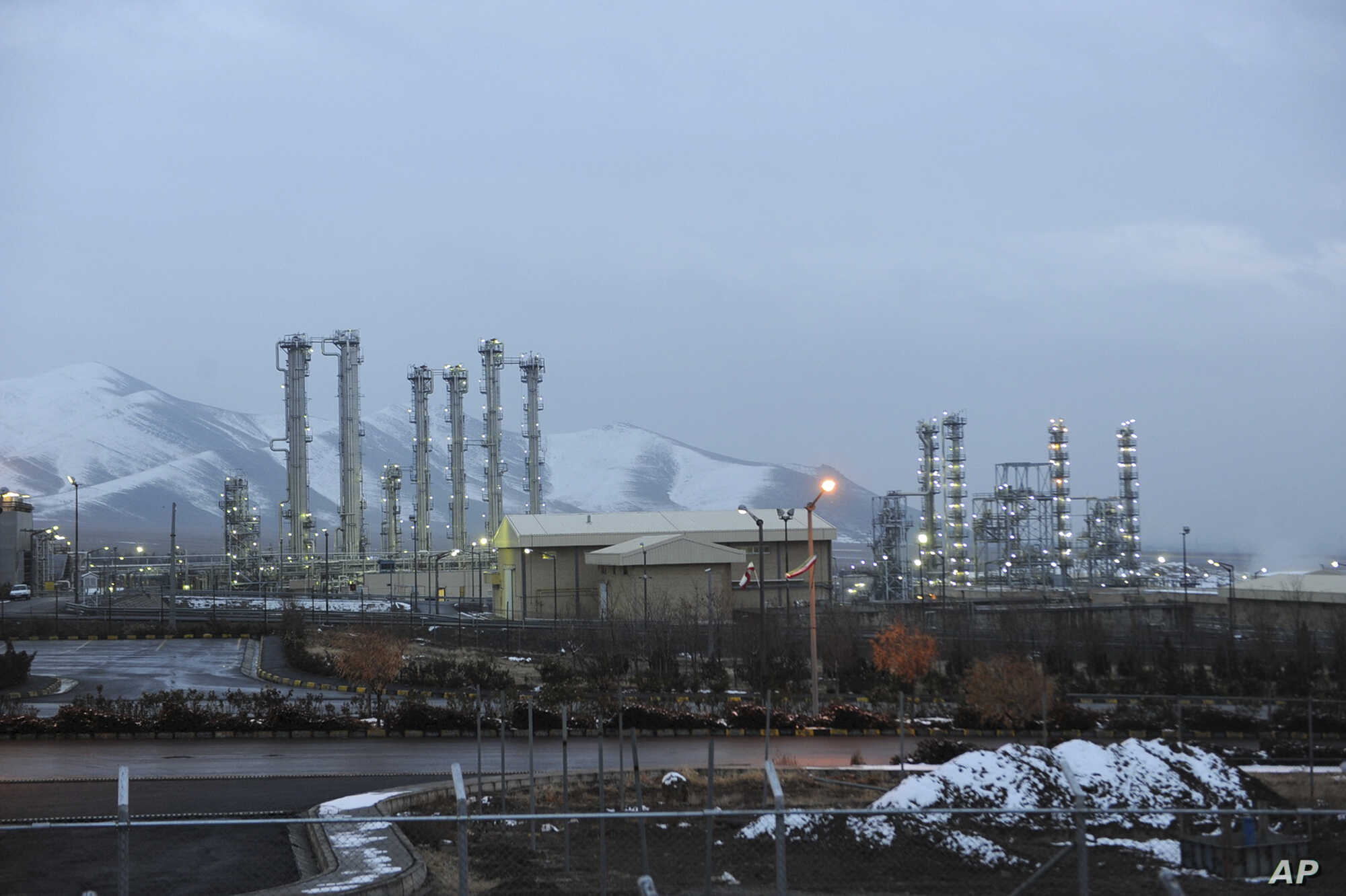 FILE - Iran's heavy water nuclear facility is backdropped by mountains near the central city of Arak, Iran. Iran and world powers are negotiating the terms of a permanent deal over its contested nuclear program.