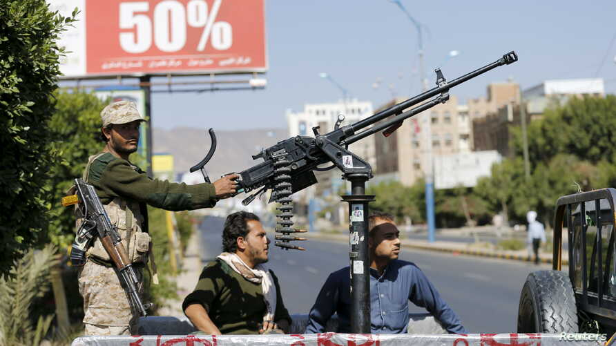 A Houthi fighter mans a machine gun on an army patrol truck while securing a road where people demonstrated against the Saudi-led air strikes in Yemen's capital Sana'a, Oct. 18, 2015.