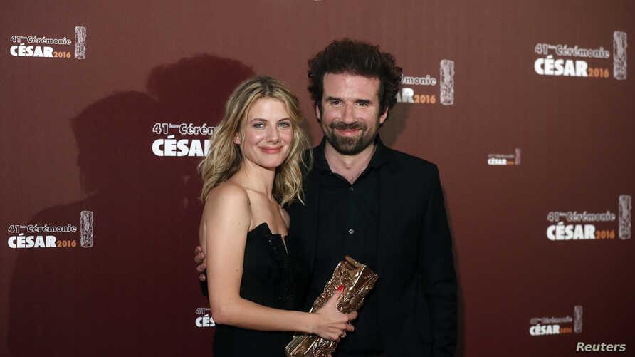 """Directors Melanie Laurent and Cyril Dion hold their trophy after receiving the Best Documentary Feature Award for their film """"Tomorrow"""" at the 41st Cesar Awards in Paris, Feb. 26, 2016."""