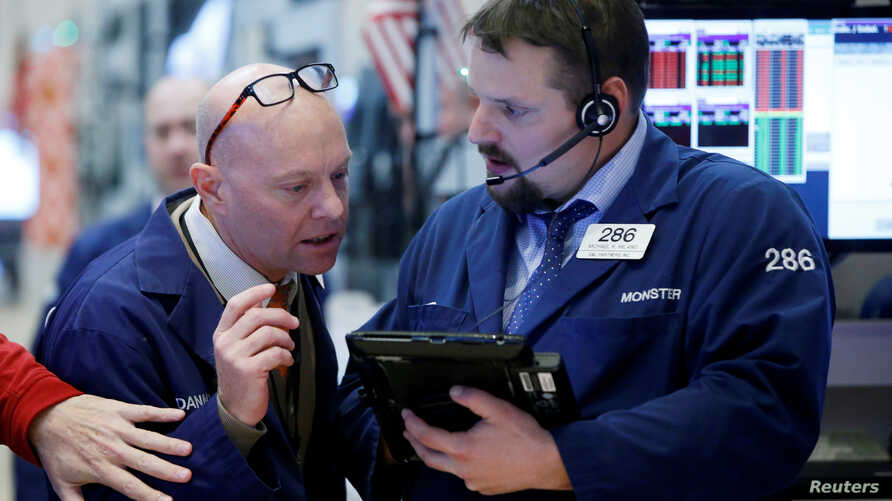 Traders work on the floor of the New York Stock Exchange in New York City, Friday, Dec. 16, 2016.