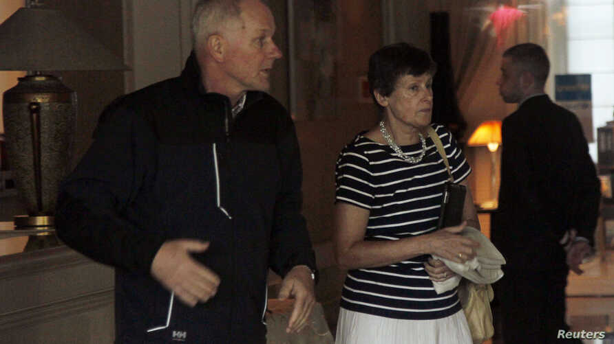U.N. High Representative for Disarmament Affairs Angela Kane and Ake Sellstrom (L), the head of a U.N. chemical weapons investigation team, leave their hotel in Damascus, Syria, Aug. 27, 2013.