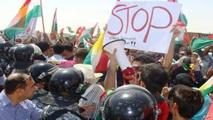 Iraqi Kurds protest Turkish, Iranian air strikes and shelling of Iraqi Kurdistan border areas on Wednesday, Aug. 24, 2011.