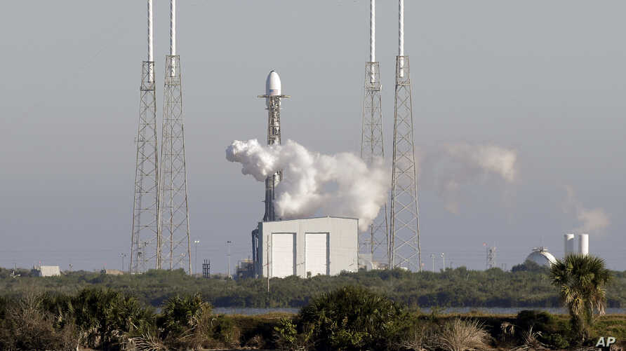 A Falcon 9 SpaceX rocket, stands ready at space launch complex 40, shortly before the launch was scrubbed because of a technical issue at the Cape Canaveral Air Force Station in Cape Canaveral, Fla., Dec. 18, 2018.