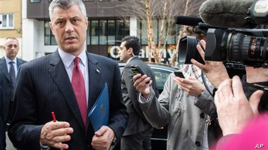 Kosovo's Prime Minister Hashim Thaci talks with journalists as he arrives for a meeting with EU foreign policy chief Catherine Ashton at the European Diplomatic Service headquarters in Brussels, Wednesday April 17, 2013. (AP Photo/Geert Vanden Wijnga