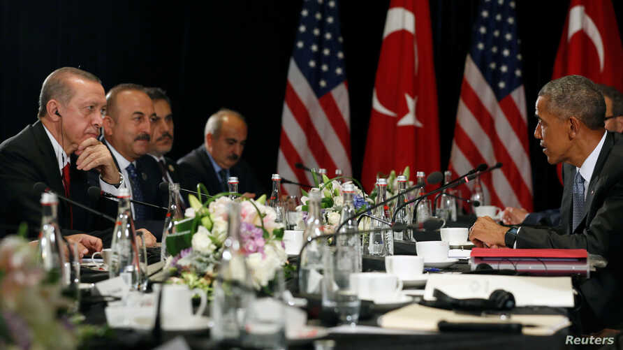 Turkey's President Tayyip Erdogan (L) listens to remarks by U.S. President Barack Obama (R) to reporters after their bilateral meeting alongside the G20 Summit, in Hangzhou, China, Sept. 4, 2016.