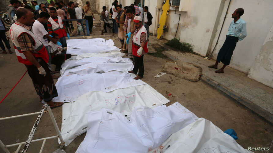 Bodies of people killed by an airstrike on a fish market are laid out in plastic bags at a hospital in Hodeida, Yemen, Aug. 2, 2018.