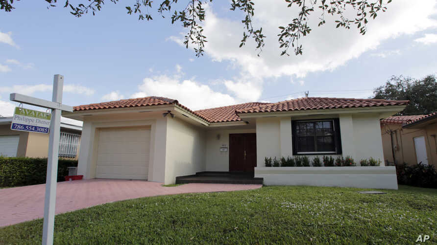 A report by S&P Case-Shiller shows a sharp rise in home prices over the past 12 months, increasing at the fastest pace since July 2014. Photo shows a house for sale in Coral Gables, Florida, Dec. 5, 2016.
