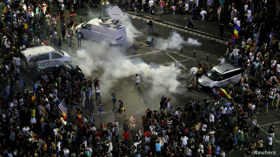 Teargas canisters explode as thousands of Romanians join an anti-government rally in the capital Bucharest, Romania, Aug. 10, 2018.