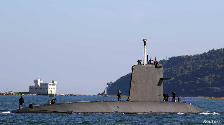 FILE - A French attack nuclear-powered submarine leaves the Toulon military harbor.
