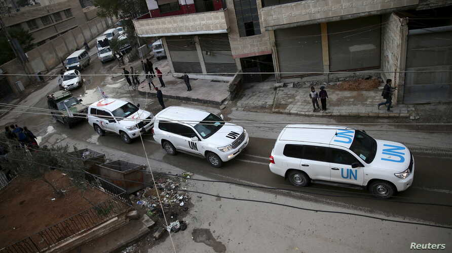 An aid convoy of Syrian Arab Red Crescent and UN drives through the rebel held besieged city of Douma towards the besieged town of Kafr Batna to deliver aid, on the outskirts of Damascus, Syria, Feb. 23, 2016.