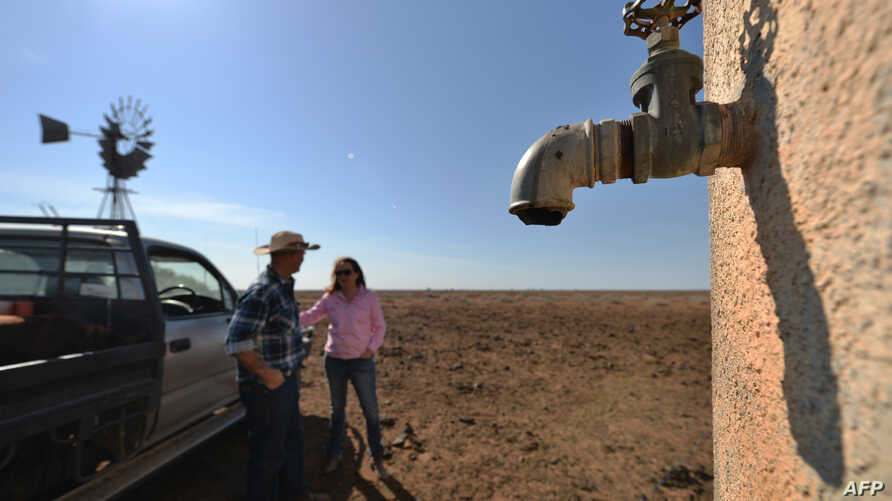 Farmers Matt and Sandra Ireson on their property, Sept. 28, 2018, during a severe and prolonged drought outside the town of Booligal in western New South Wales. Rainfall in 2018 was 75 percent below average.