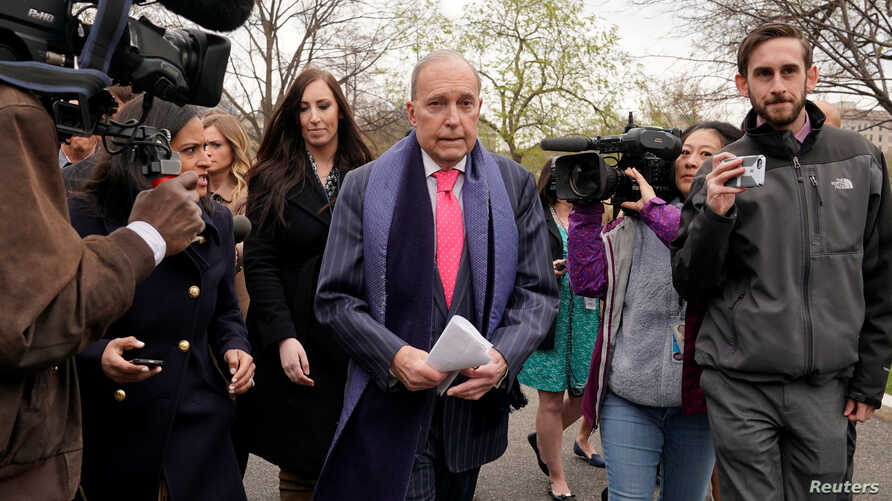 FILE - U.S. President Donald Trump's economic adviser Larry Kudlow is trailed by reporters after speaking at the White House in Washington, April 6, 2018.