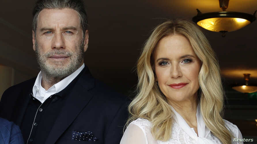 """John Travolta and Kelly Preston promote the film """"Gotti"""" at the 71st Cannes Film Festival in Cannes, France, May 14, 2018."""