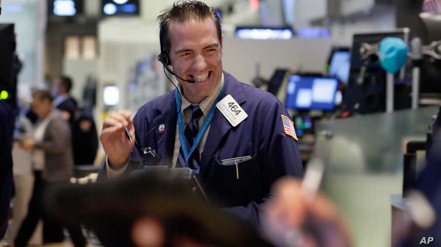 FILE - Financial Markets Wall Street: Trader Gregory Rowe works on the floor of the New York Stock Exchange.
