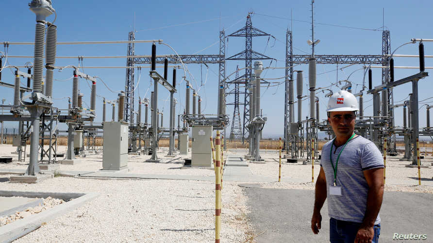 An Israeli engineer stands at an electrical substation near the West Bank city of Jenin, July 10, 2017.