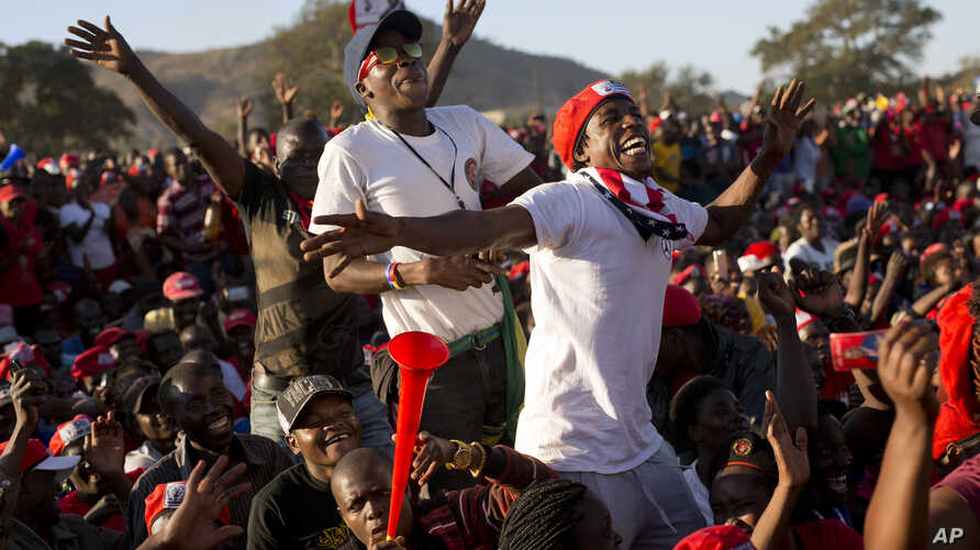 Opposition party supporters cheer opposition challenger Nelson Chamisa at a campaign rally in Bindura, Zimbabwe, July 27, 2018.
