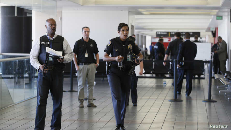LAPD officers walk around terminal 3 after a shooting at Los Angeles airport (LAX), California, Nov. 1, 2013.