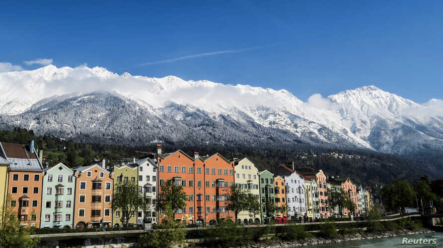 FILE - The snow-covered Nordkette mountains are pictured behind the city of Innsbruck, Austria, April 21, 2017.