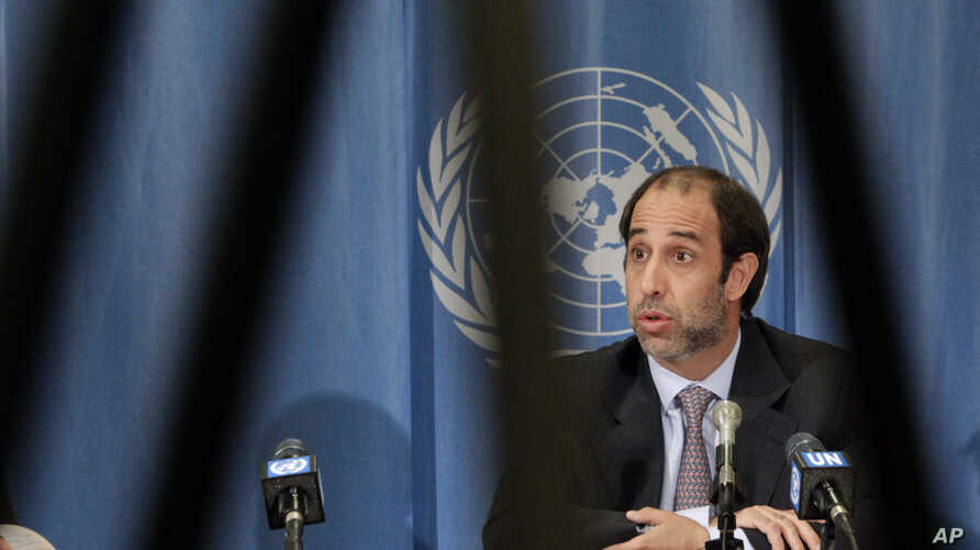Tomas Ojea Quintana, United Nations Special Rapporteur on the situation of human rights in Myanmar is pictured through a television tripod during a news conference (file photo)