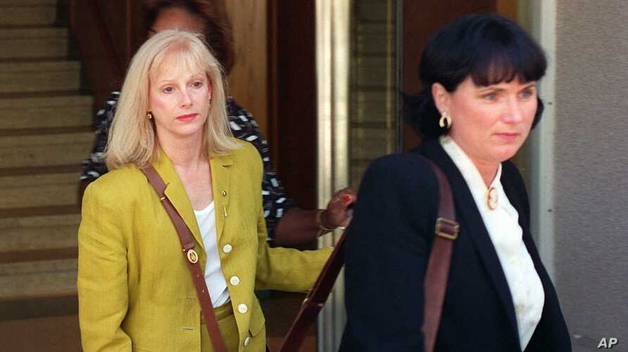 Sondra Locke, left, leaves court in Burbank, Calif., with her attorney Peggy Garrity, Sept. 11, 1996, after opening statements in a civil suit against Locke's former live-in boyfriend, Clint Eastwood.